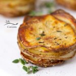 square crop of close up on stacked and roasted potato slices
