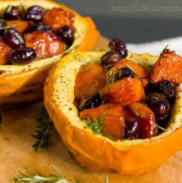 Roasted Acorn Squash with Black Grapes and Cardamom Persimmons https://lifecurrentsblog.com