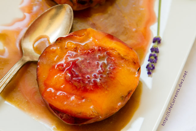 Grilled Peaches with Cointreau Caramel Sauce - the perfect early fall dessert that takes almost no time at all to whip up, and your friends will be amazed at how delicious it is!