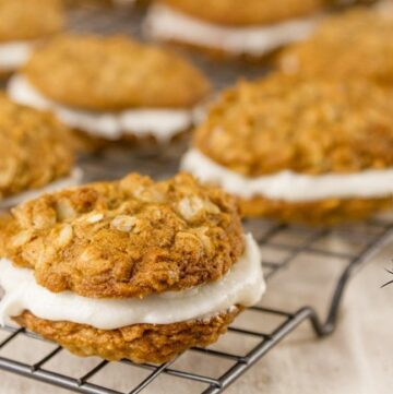Oatmeal Sandwich Cookies Recipe Homey comforting oatmeal cookies wrapped around sweet creamy white filling.