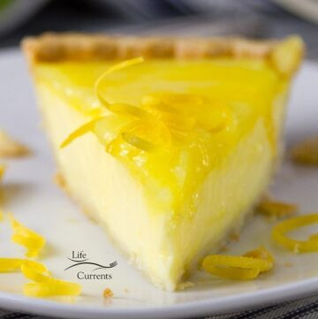 Grandma's Lemon Custard Pie close up picture with the curd layer visible straight onto the slice