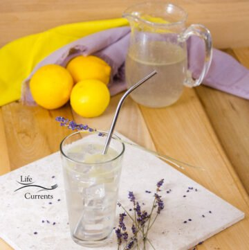 Square image of Lavender Lemonade with lemons in the background