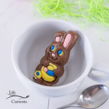 a chocolate Easter bunny in a white mug